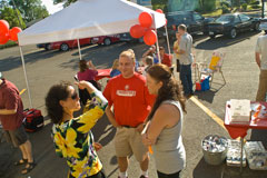 Jason Heckel from Cold Stone Creamery in Corvallis talks with attendees at Chris Nordyke State Farm's July barbeque