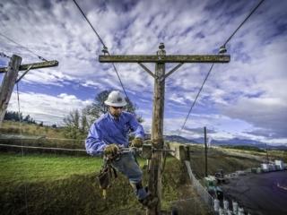 Consumer's Power Lineman Working above ground