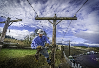 Consumer's Power Lineman Working above ground