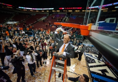 Oregon State University Women's Basketball Coach Scott Rueck Celebrates his team's Pac-12 Championship